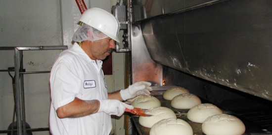 A BCTGM member at the IBC-owned Parisian sourdough bread bakery in San Francisco. The bakery had been producing bread for 149 years before it was shuttered by the company in 2004, only a few months after IBC filed for bankruptcy the first time.