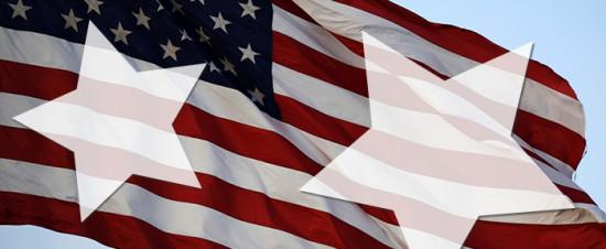 american flag on blue cloudy sky at dusk
